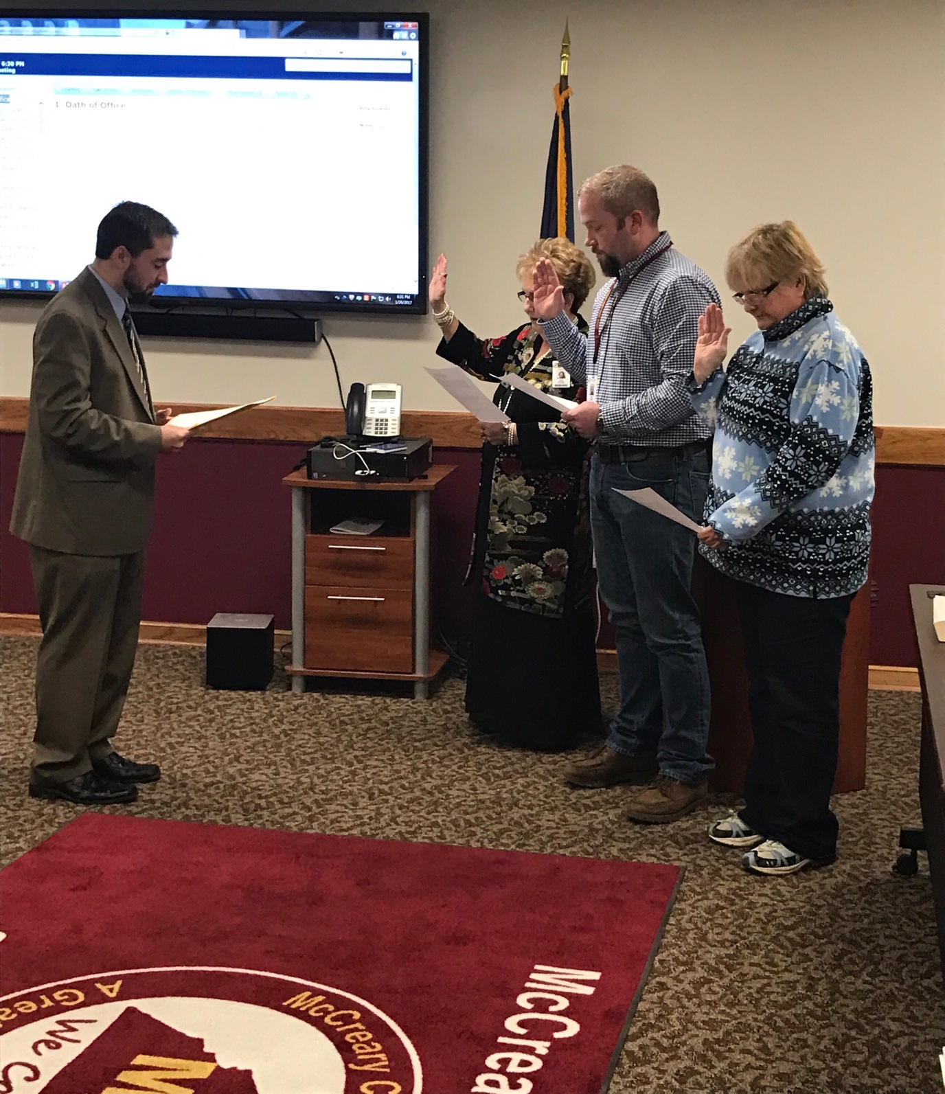 County Attorney Conley Chaney officiating the swearing in ceremony for District #1 board member Nelda Gilreath, District #3 board member Dustin Stephens, and District #5 board member Debbie Gibson.