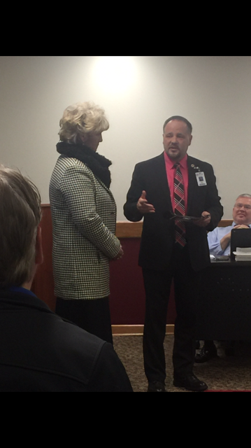 Supt. Cash presents Superintendent Award to Cindy Moore